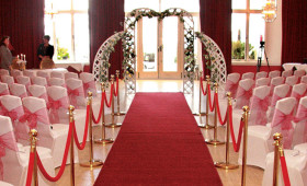 Ballroom layed out for civil ceremony in the Ballroom